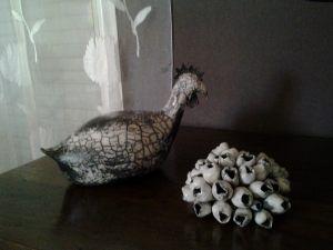 Poule et coquillage